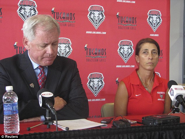 University of New Mexico vice president of athletics Paul Krebs (left) and women's head soccer coach Kit Vela speak to reporters on Wednesday. She has been suspended following the hazing incident on the team