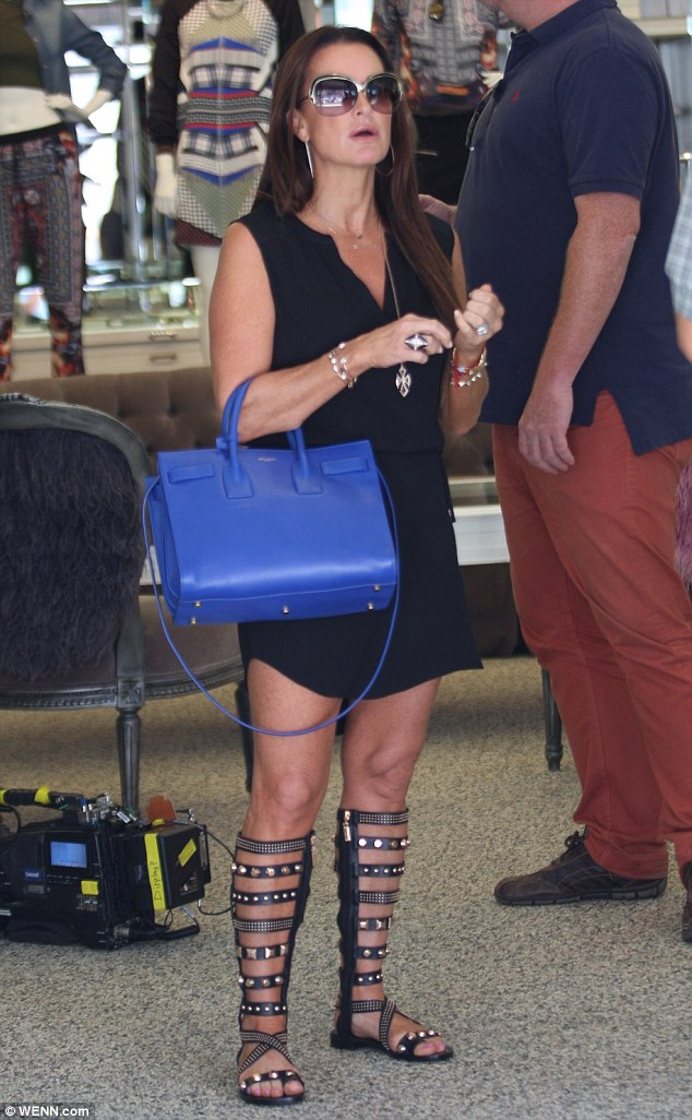 On trend: Kyle Richards sported a pair of Roman gladiator themed sandals for an appearance in Beverly Hills on Wednesday