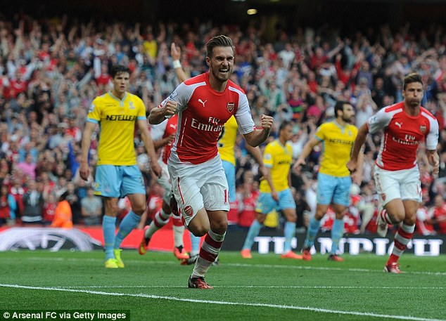 Promising signs: Millen took charge of the narrow defeat by Arsenal on the opening day of the season