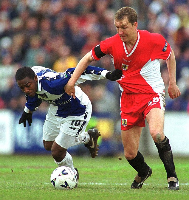 Back in the day: Millen gets to grips with Nathan Ellington during his playing career at Bristol City