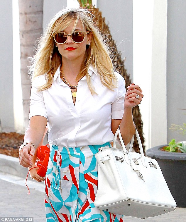 Business woman: On Thursday Reese Witherspoon was spotted visiting an office in Beverly Hills, California while looking chic in a classy ensemble with sassy red accents