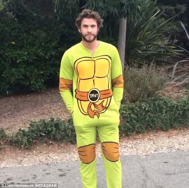 That's different: Liam Hemsworth did his Ice Bucket Challenge for ALS on Wednesday in a Teenage Mutant Ninja Turtles costume