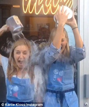 Scream! Model Karie Kloss and a friend take part in the challenge with tins of ice water