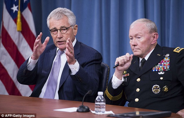 Mission: US Secretary of Defense Chuck Hagel (L) and Chairman of the Joint Chiefs of Staff General Martin Dempsey hold a press briefing at the Pentagon in Washington on Thursday