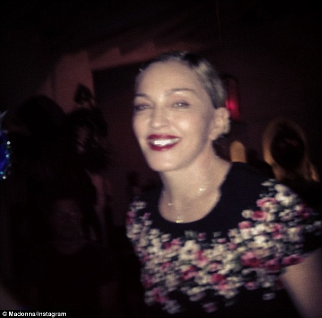 'Happy and tired': The Material Girl hitmaker shared a close-up of her pretty face from the same evening
