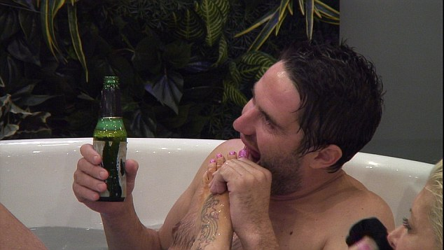 Setting the tone for the evening... The Gogglebox star sucked on Frenchy's toes as he held a beer in one hand