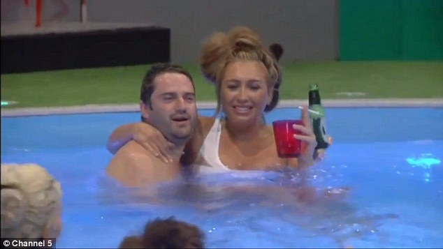 Living it up: George and Lauren got close as they drank together while enjoying their late night swim