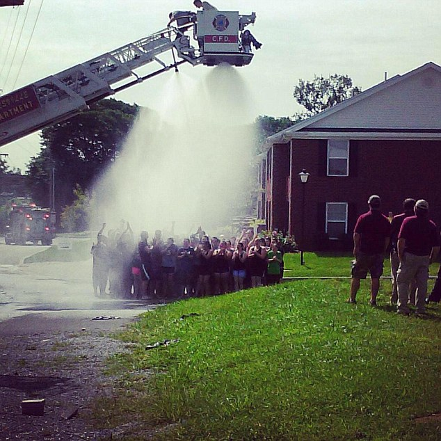For a good cause: Two firefighters remain hospitalized after suffering electric shocks while helping with this ALS ice bucket challenge at Campbellsville University in Kentucky. A picture of the firefighters helping out with the challenge, seen above