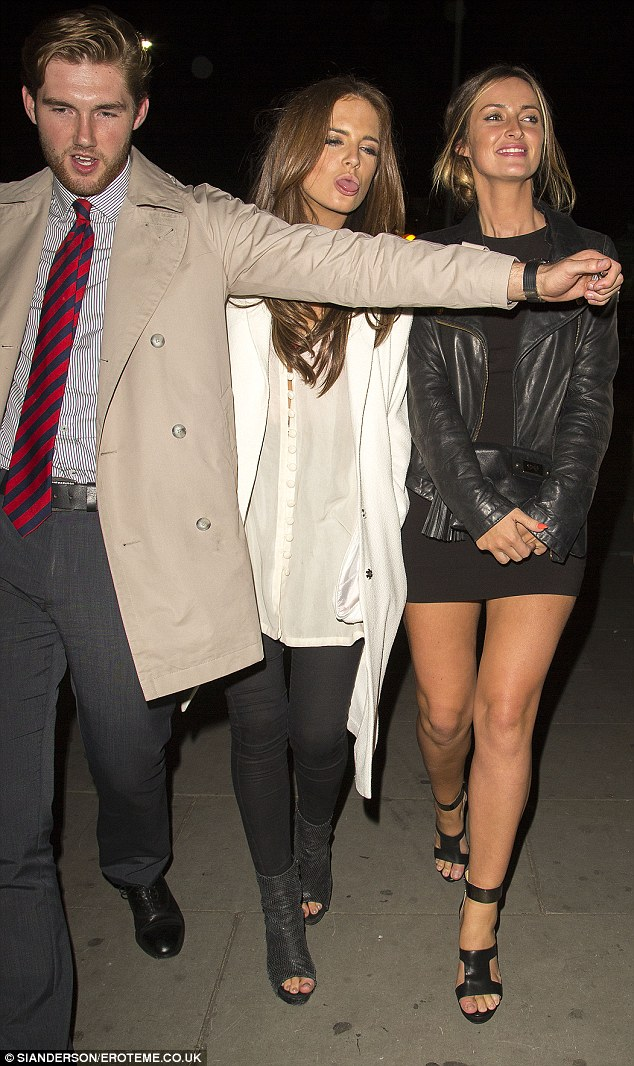 Eye-catching: Binky looked typically stylish in a white blouse, black leggings and peep-toe boots for her night out at the Cuban themed nightclub in her native Chelsea