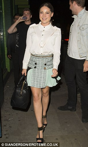 At large: Pal Louise Thompson, another guest on the night, opted for a military style shirt and mint green miniskirt