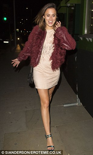 At large: Lucy teamed her outfit with a fur-lined burgundy leather jacket