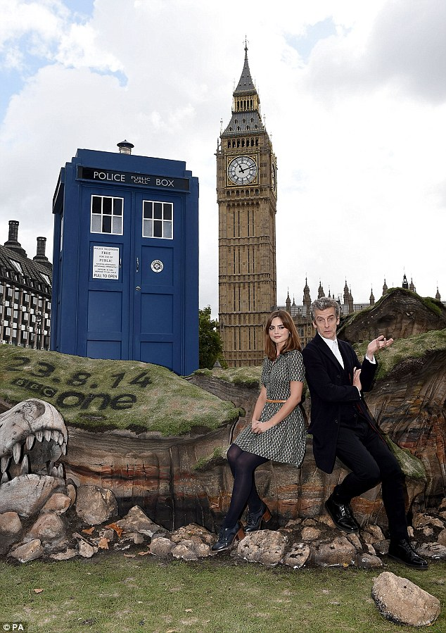 Back in town: Jenna Louise Coleman and Peter Capaldi return to London's Parliament Square with the Tardis as they get set to debut the new series this Saturday