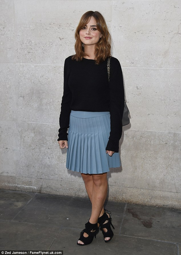 Preppy get up: The 28-year-old looked cute in a pleated mini skirt, that she paired with a plain black jumper