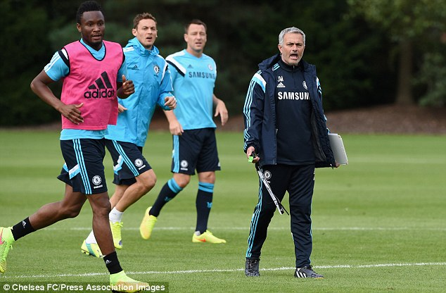 Difficult: Jose Mourinho (right) has offered no explanation to Petr Cech on his axing as Chelsea No 1
