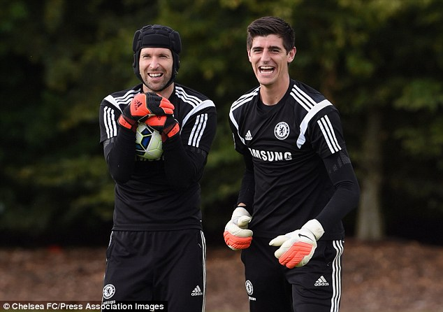 All smiles: Cech (left) and Courtois manage to see the funny side during training on Friday