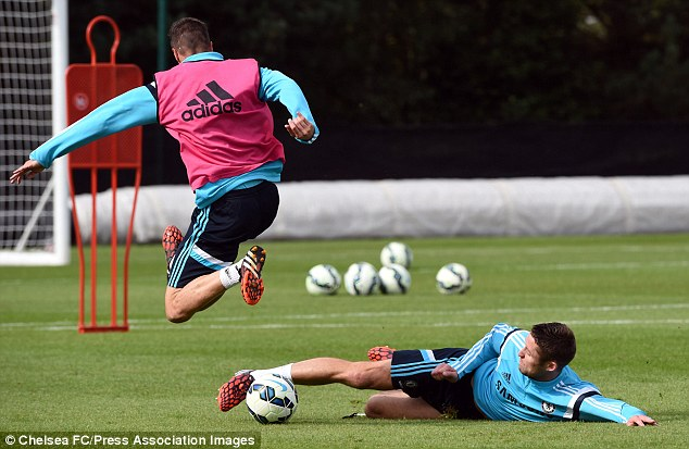 Tackle: Gary Cahill (right) slides in to win the ball from Chelsea striker Fernando Torres