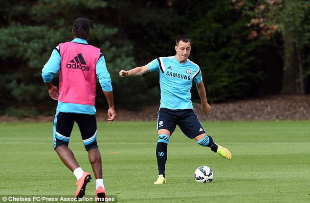 Legends: Chelsea captain John Terry (right) passes the ball as Didier Drogba looks to close him down