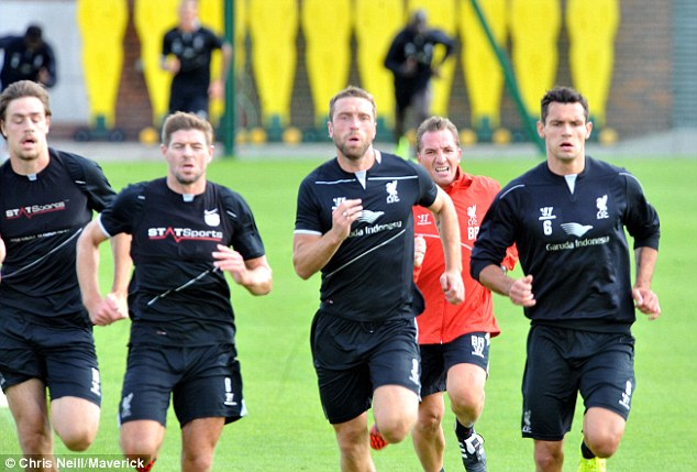Keep up, Brendan! Brendan Rodgers attempts to keep pace with Liverpool starts Sebastian Coates, Steven Gerrard, Rickie Lambert and Dejan Lovren in training ahead of the clash with Manchester City