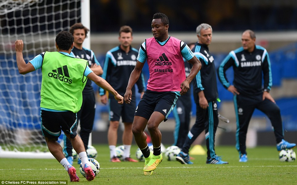 Endeavour: Jon Obi Mikel challenges Mohamed Salah for the ball in the training session while under the watchful eye of his manager and coaching staff