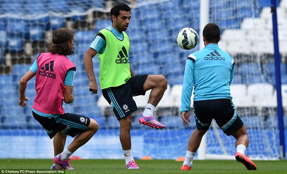 Keepy up: Salah controls the ball with Luiz and Hazard in close proximity on the Stamford Bridge turf