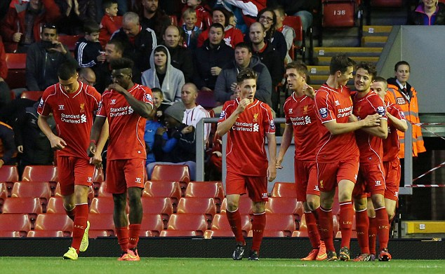 Get in! Liverpool's youngsters celebrate afterLussey scored a free-kick in front of the Kop