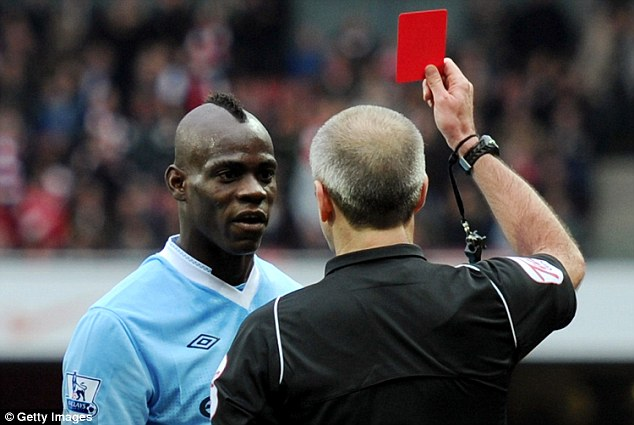 Ordered off: Balotelli is shown a red card during Manchester City's 1-0 defeat by Arsenal in April 2012