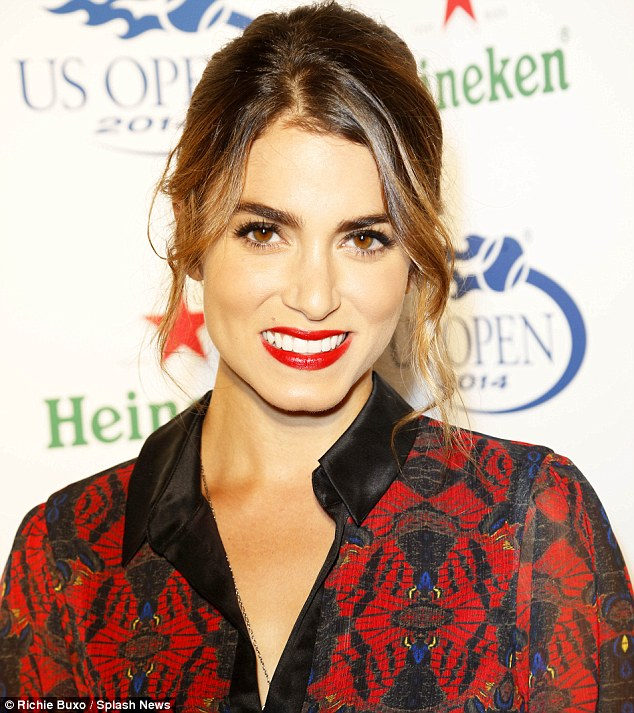 Favourite colour: The 27-year-old also wore a bright shade of red on her lips