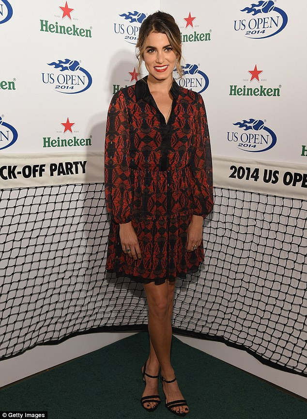 Lady in red: Julianne was joined on the tennis court green red carpet by Nikki Reed, whom embraced bright colour in a red dress
