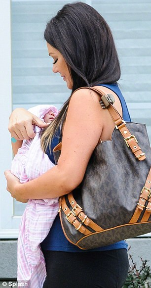 Mother-daughter duo: The Jersey Shore star, pictured carrying newborn daughter, Meilani, in New Jersey in July, said she wouldn't have plastic surgery on her face because 'you can never go back'