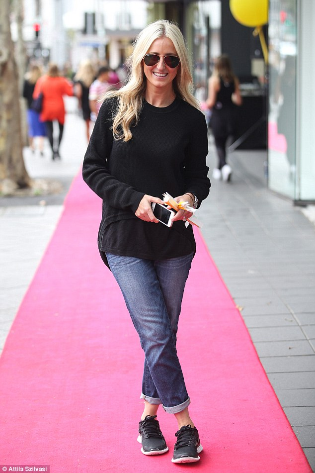 Casual: While on the job Roxy looked effortlessly beautiful in blue jeans and a warm black jumper
