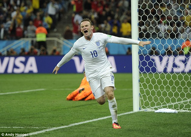 On target: England forward Wayne Rooney celebrates after scoring against Uruguay at the 2014 World Cup