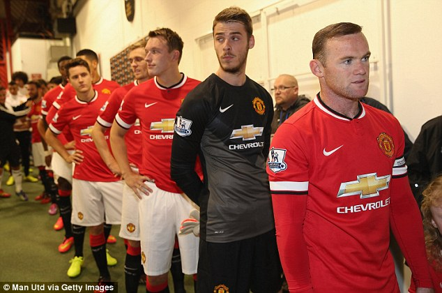 Captain: Rooney (right) leads out Manchester United for the pre-season friendly against Valencia on August 12