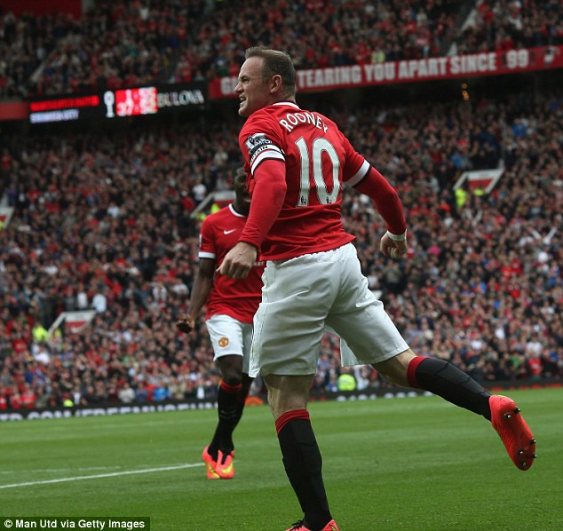 Red devil: Rooney celebrates scoring for Manchester United against Swansea in their Premier League opener