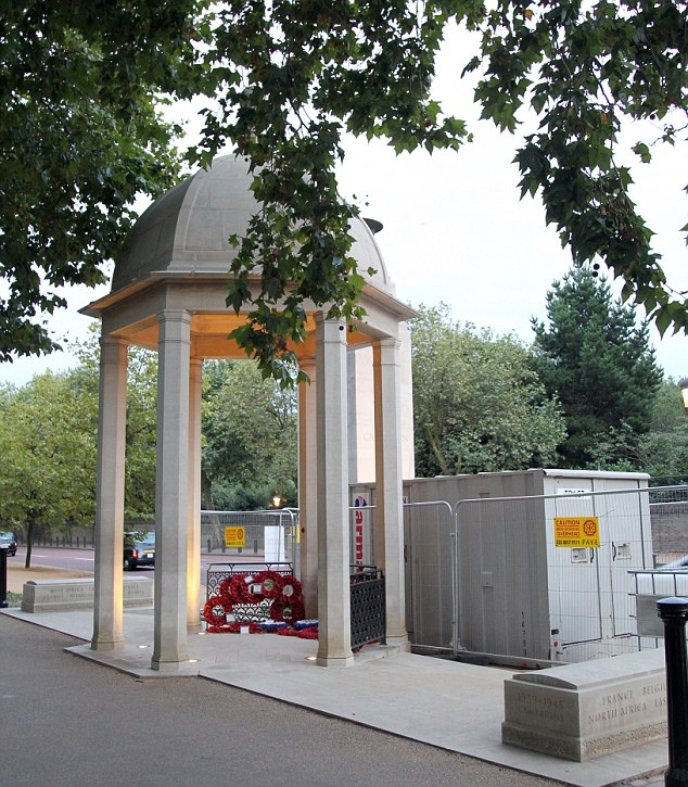 The temporary toilet block has been placed beside the Commonwealth Memorial Gates in London