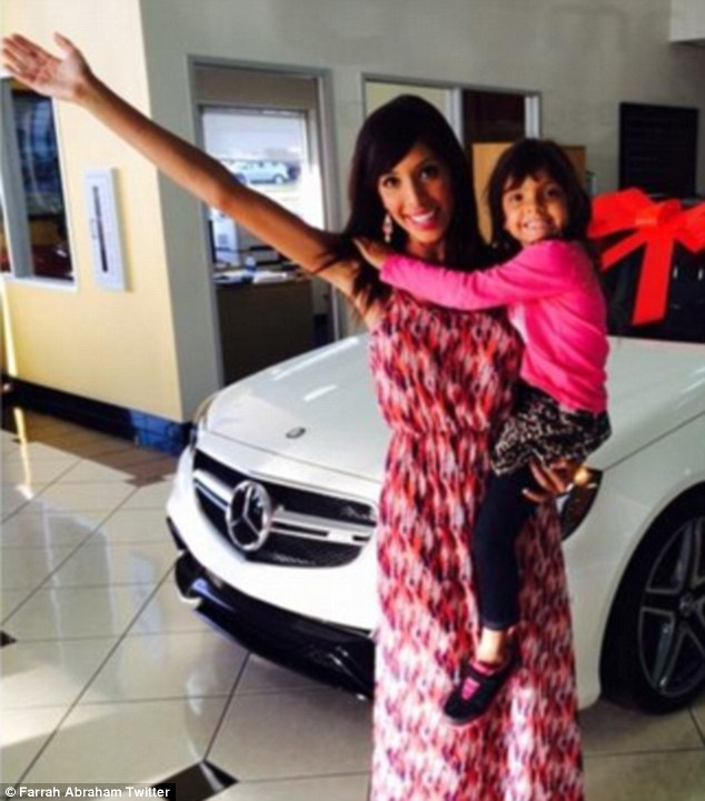 Helping hand: Farrah brought daughter Sophia along to help pick up her shiny white Mercedes-Benz E-Class
