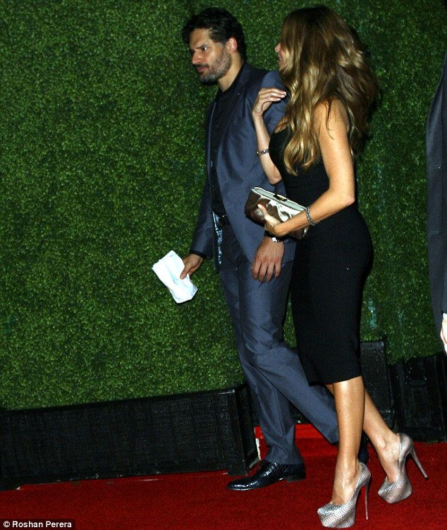 Adding height: The 5ft7 beauty sported a pair of sky-high snakeskin platform pumps with her sexy dress
