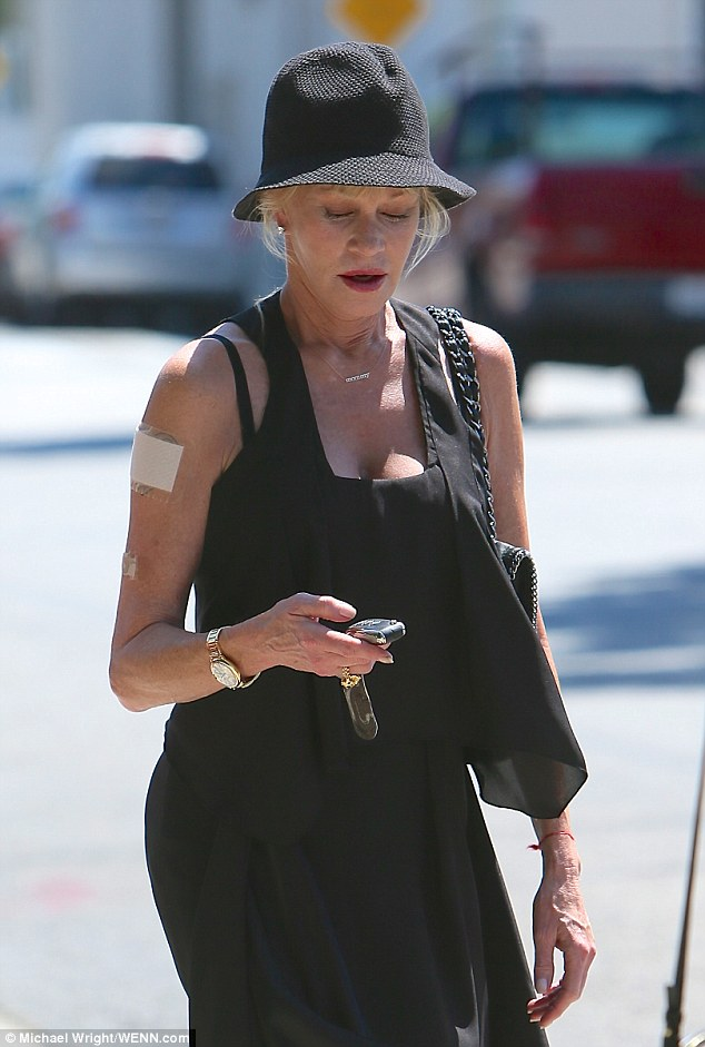 Conceal: Melanie Griffith was spotted covering up the infamous ink with a patch as she left Gracias Madre restaurant in West Hollywood on Friday