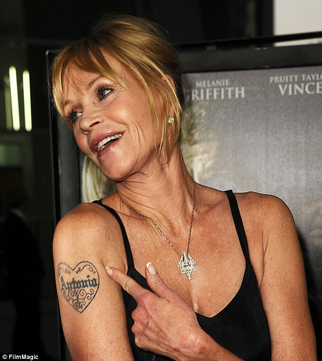 Infamous ink: She flashed her tattoo at a premiere last year