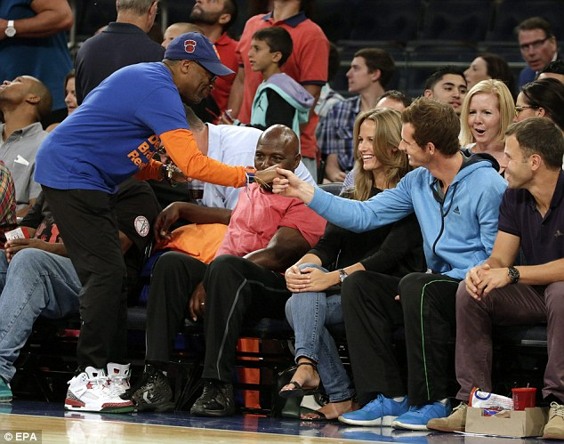 Nice to meet you: American director Spike Lee shakes hands with Murray at the basketball match
