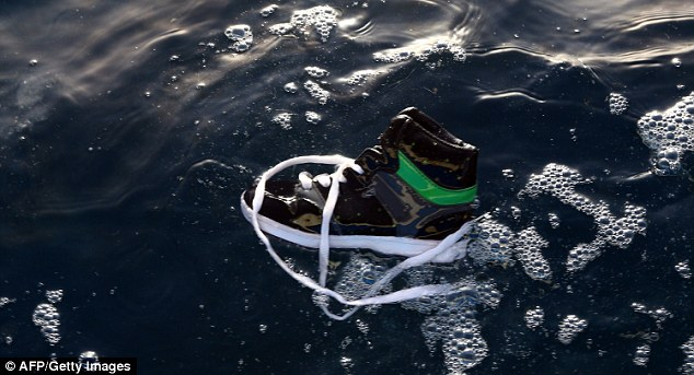 A shoe belonging to an illegal immigrant floats on the water after the boat carrying men, women and children sank. The victims were among the hundreds trying to flee Libya on a daily basis