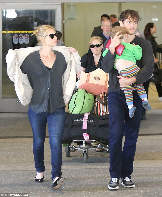The weary travelers: Claire Danes touched down at LAX on Sunday with her husband Hugh Dancy and their son Cyrus just two days before the Emmy award show
