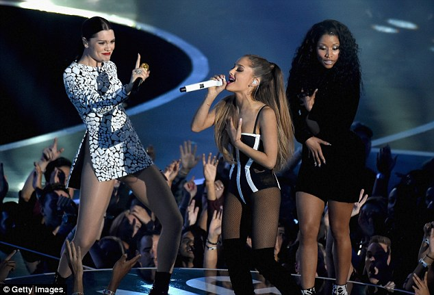 Wardrobe malfunction: Shortly after her showstopping Anaconda performance Minaj was forced to awkwardly hold her LBD together while belting Bang Bang onstage with Jessie J and Ariana Grande