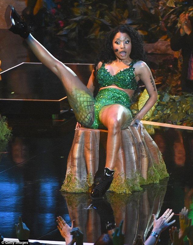 'Oh my God look at her butt!' Minaj had her upper thighs painted in snakeskin but she performed sans anaconda after the reptile allegedly bit one of her dancers during the rehearsal