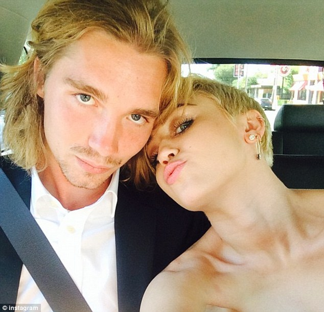Limo ride: Cyrus posed with the young Oregon man as they rode to the Video Music Awards together on Sunday