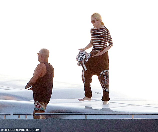 Queen of fitness: Madonna was seen exercising and stretching on a yacht during her trip to Ibiza last week