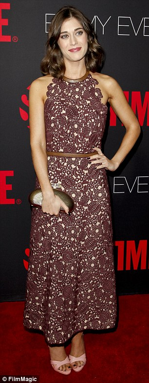 Stiff competition: Lizzy Caplan, another award hopeful, wore a sleeveless halterneck dress with a bold burgundy print