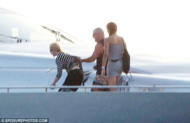 The big cover-up: Madonna has been cautiously keeping her skin guarded from the sun as she holidays