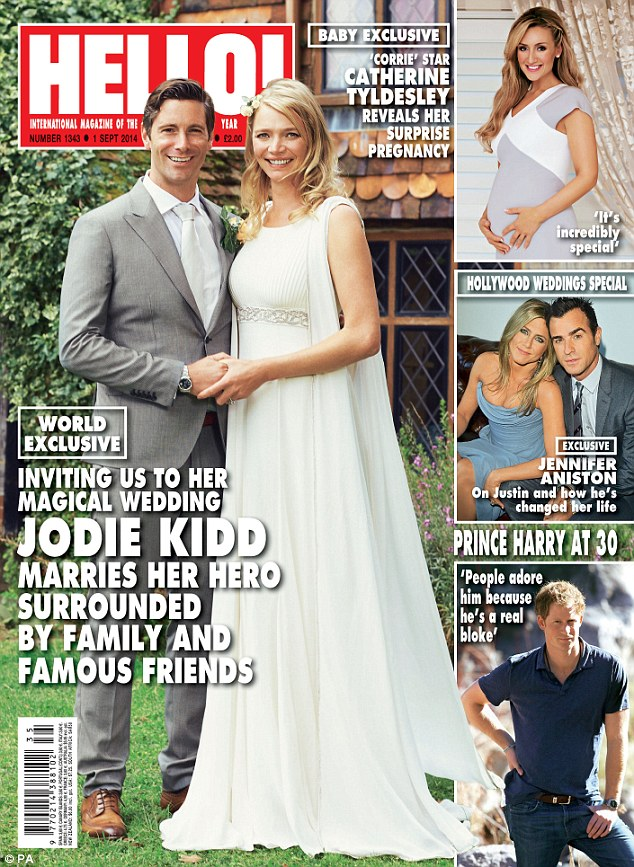 Cover stars: Jodie looked beautiful in her floor-length Zaeem Jamal gown and her husband looked dapper in a grey suit. The pair's wedding features in this week's Hello! magazine, where they talk about their whirwind romance