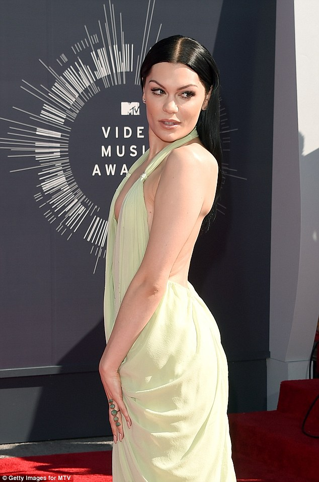 Wow: The Price Tag hitmaker looked stunning in the pale green vintage Halston dress