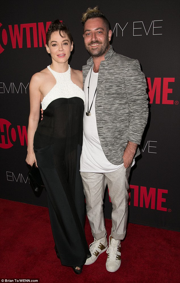 Say cheese: Rose McGowan poses for a snap with husband Davey Detail